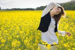 Girl in rapeseed field Royalty Free Stock Photography