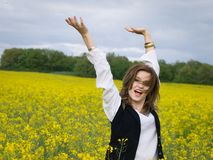 Girl in rapeseed field Royalty Free Stock Photos