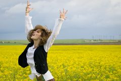 Girl in rapeseed field Royalty Free Stock Images