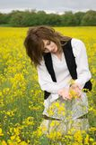 Girl in rapeseed field Stock Image