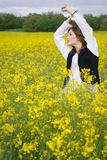 Girl in rapeseed field Royalty Free Stock Photo