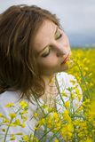 Girl in rapeseed field Stock Photo
