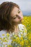 Girl in rapeseed field Stock Photo