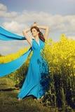 Girl in rapeseed field Stock Photos