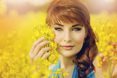Girl in rapeseed field Royalty Free Stock Image