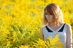 Girl in the rapeseed field Royalty Free Stock Image