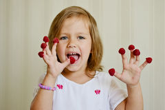 Girl with raspberry Royalty Free Stock Image