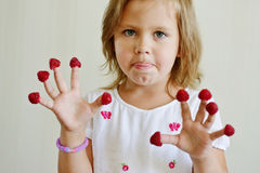 Girl with raspberry Royalty Free Stock Photo