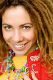 Girl-rastaman close up. Young beautiful woman with dreadlocks and red jacket Royalty Free Stock Photography