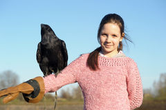 Girl with raven Royalty Free Stock Photo