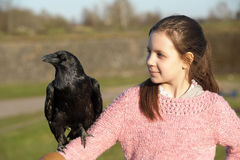 Girl with raven Stock Photos