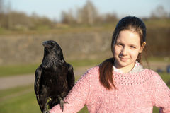 Girl with raven Royalty Free Stock Photos