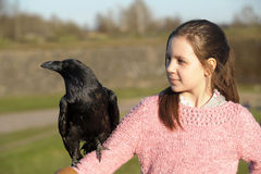 Girl with raven Stock Photography