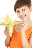 Girl with raw corn, maize. Happy young woman with raw corn, maize Stock Photo