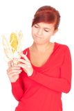 Girl with raw corn, maize Royalty Free Stock Photo