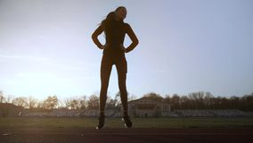 The girl performs fitness exercises at the stadium. stock video