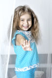 Girl reached. Out between the curtains Stock Photography