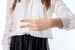 The girl reached out and keeps itself the two finger zoom Royalty Free Stock Photo
