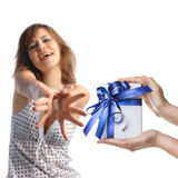 A girl reaching out for gift Royalty Free Stock Photo