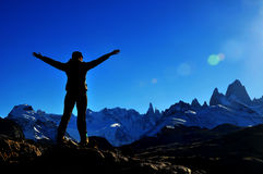 Girl reaching the summit of the mountain in El Chalten, Argentina Stock Photos