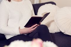 Girl read Bible at home Stock Images
