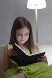 Girl read book. Beauty girl read book on sofa Royalty Free Stock Photography