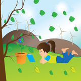 Girl readind a book. Girl reading a book under a tree Royalty Free Stock Photo