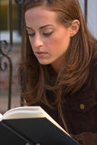 Girl Reading 1. Young woman reading/studying Stock Images