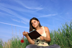 Girl reading. Cute girl learning in nature Royalty Free Stock Images