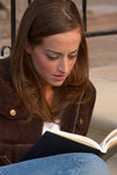 Girl Reading 2. Young woman reading/studying Royalty Free Stock Photography