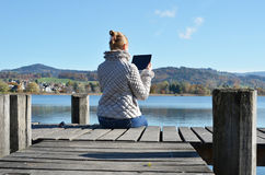 Girl reading from ateblet Royalty Free Stock Images