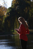 Girl reading in autumn park Stock Images