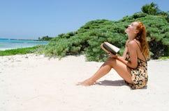 Girl reading at beach Stock Photos
