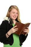 Girl Reading Bible with Pet Rat on Shoulder Stock Images