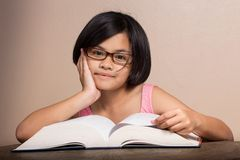 Girl reading big book Royalty Free Stock Photography