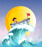 A girl reading on a boat at the top of the big wave Royalty Free Stock Photo