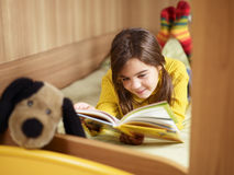 Girl reading book royalty free stock images