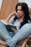 Girl reading the book Royalty Free Stock Images