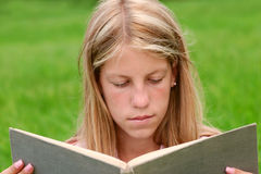 Girl reading book. Girl holding book and reading Royalty Free Stock Photos