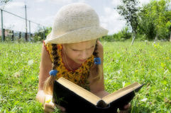 The girl are reading the book Stock Photos