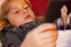 Girl Reading A Book 2 Stock Images
