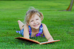 Girl reading book. Royalty Free Stock Image