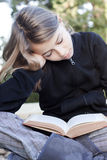 Girl reading book. Teenage child studying, reading a book Royalty Free Stock Image