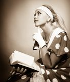 Girl reading a book Stock Photography