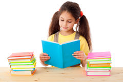 Girl reading the book Stock Images