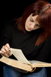 Girl reading a book. Girl turning a page in a dictionary. Shot in studio royalty free stock photo
