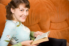 Girl reading book Stock Image