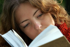 Girl is reading a book stock photo