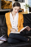 The girl reading a book with absorbed axpression Stock Images