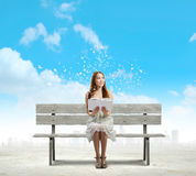 Girl reading book Stock Images